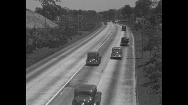 """roads! more roads!"" / title card: ""editor's note: america is on the road, in small cars and in big ones – on long trips and week-ends, vacation time... - graph stock videos & royalty-free footage"