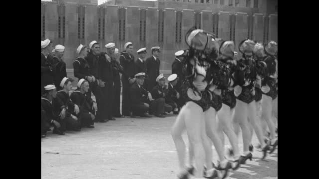 """rockettes put kick in fleet visit - music hall dancers do famous number to welcome sailors"" / two shots of rockettes performing dance routine as... - radio city music hall stock videos & royalty-free footage"