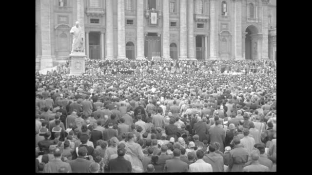 rome superimposed over people walking away from camera toward st peter's basilica for annual easter service there / rear ws crowd in st peter's... - petersplatz stock-videos und b-roll-filmmaterial