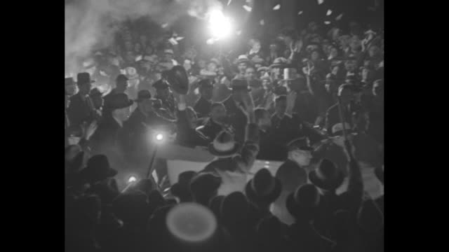 roosevelt for action chicago's rousing torchlight parade marked climax of countrywide tour / night crowd with torches line street lots of smoke / ms... - head torch stock videos & royalty-free footage