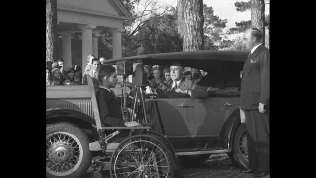 """""""roosevelt hails model warm springs"""" / us pres. franklin d. roosevelt arrives driving car at warm springs / roosevelt speaking from car, man standing... - polio stock videos & royalty-free footage"""