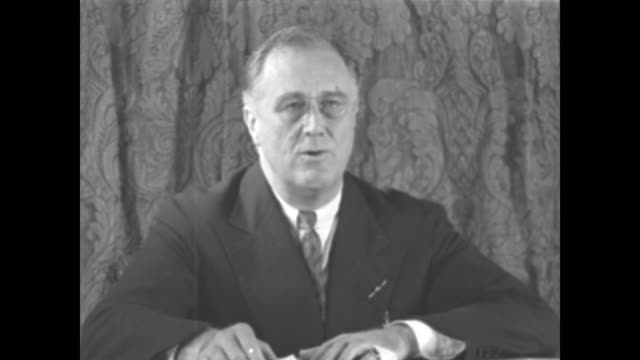 vídeos de stock e filmes b-roll de roosevelt reports on recovery / ms us pres franklin roosevelt sitting in front of brocaded curtain and wearing pincenez reads excerpts of his... - franklin roosevelt