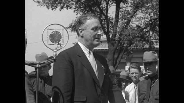 vídeos de stock e filmes b-roll de roosevelt talks to farmers on tax reduction state executive explains revenue problems to syracuse mass meeting / sot ny gov franklin roosevelt says... - 1931