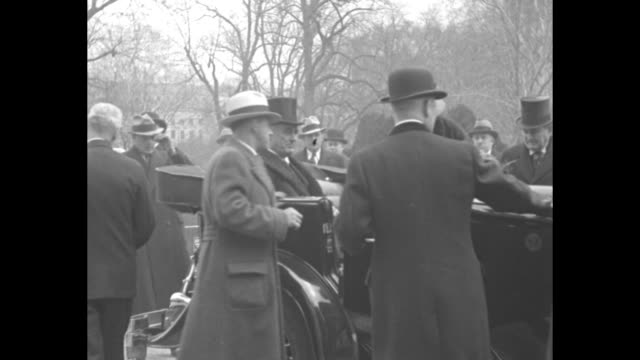 'Roosevelt's first official act as President is review of spectacular Inaugural Parade' / VS presidential motorcade proceeding toward camera along...