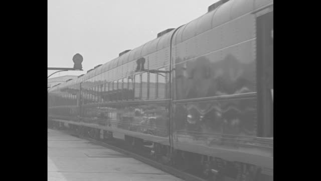 """vídeos de stock, filmes e b-roll de """"royal blue streak"""" / front of locomotive with women dignitaries on sides and men in front, some with hands ready to open stacked cages, woman... - moving past"""