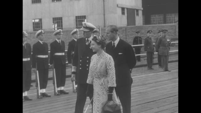 royal departure superimposed on limousine pulling up on dock in front of royal yacht ñbritanniaî / elizabeth and philip get out of limousine and are... - fluggastbrücke stock-videos und b-roll-filmmaterial