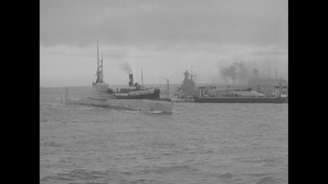 """his majesty's home fleet leaves portsmouth, eng., for spring cruise"""" / vs hms enterprise, light cruiser / view from ship of sailors lined up and... - line stock videos & royalty-free footage"""