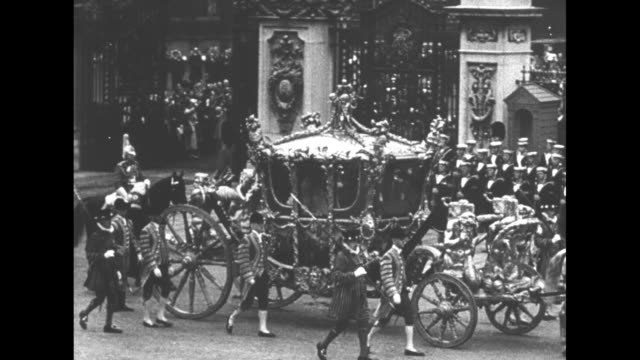 royalty britain gets king duke weds wally / [5/12/1937 london] the gold state coach rolls during george vi coronation and he is crowned inside... - 1937 stock videos & royalty-free footage
