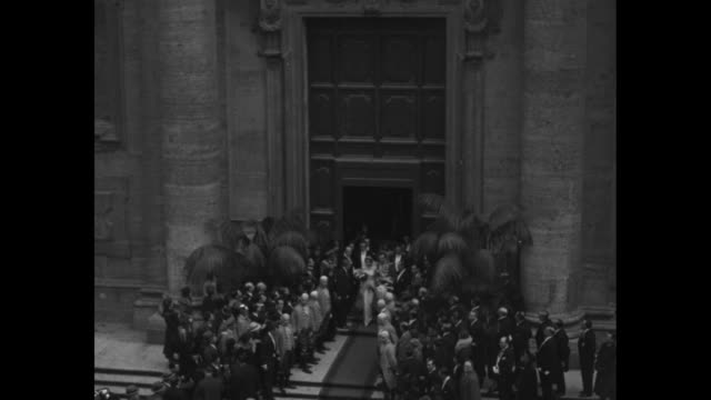 vídeos de stock e filmes b-roll de royalty in the news rome here and there with titled people don jaimeprincess dampierre wedding takes spotlight of romance / montage infante jaime... - rei