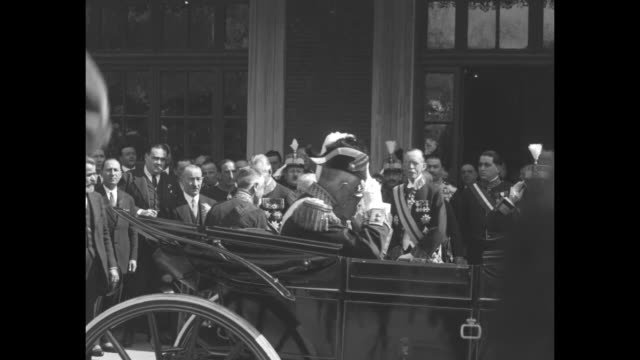 Royalty takes a holiday King Gustaf of Sweden arrives at Madrid on his tour of sunny Spain and is greeted by King Alfonso who escorts his guest to...
