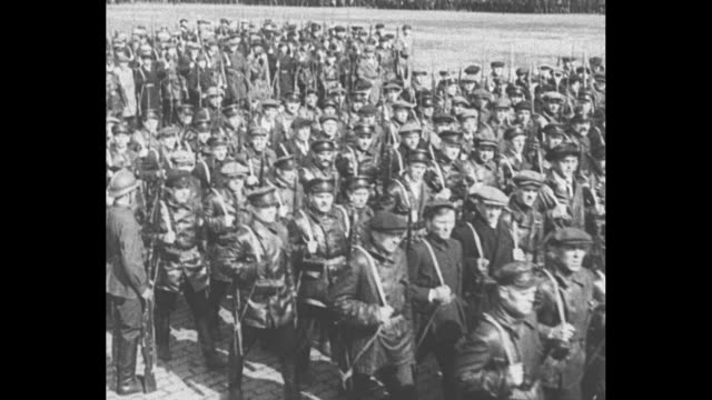 """""""russia today! - latest demonstration at moscow by red army and workers' groups"""" / ext state historical museum on red square with soldiers lined up... - soviet military stock videos & royalty-free footage"""