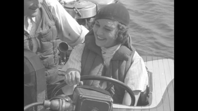 ruth elder rides waves instead of sky / mcu sot ruth elder at the wheel of hydroplane motor boat with mechanic prior to race / ls boats speed off at... - capsizing stock videos & royalty-free footage