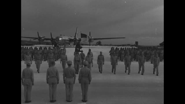 Saipan Honor B29 Crew for Tokyo Mission / World War II / B29 crew walking away from special F13 variant of the B29 plane the Tokyo Rose / side of...