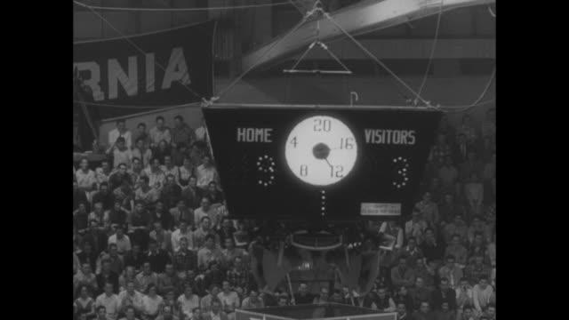 san francisco sets cage mark 40 in a row superimposed over university of san francisco uc berkeley basketball game / ws uc berkeley player passes... - university of california bildbanksvideor och videomaterial från bakom kulisserna