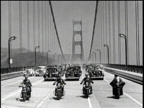 a title card says across the golden gate bridge / the bridge is shown from a far / the bridge is shown end to end / a blow torch is used to break the... - 1937 stock-videos und b-roll-filmmaterial