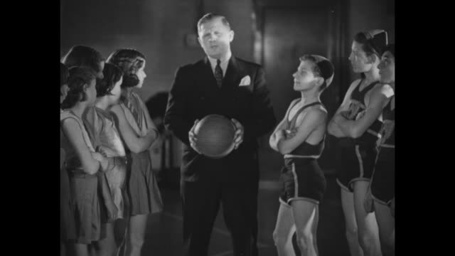 """elmer oliphant, famous army star, shows young america how to shoot baskets"""" / elmer oliphant, former football and basketball player, stands with... - west point new york stock videos & royalty-free footage"""