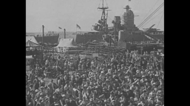 """tars aboard the 'victory' at portsmouth entertain visitors"""" / right large crowds at dock in portsmouth, england, to hms victory / tilt down mast with... - hampshire england stock videos & royalty-free footage"""