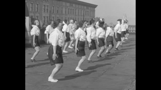 'Seattle matrons favor reduction Seattle Northwest's stout and stylish ladies war on surplus poundage at YWCA gym' / uniformed overweight women doing...
