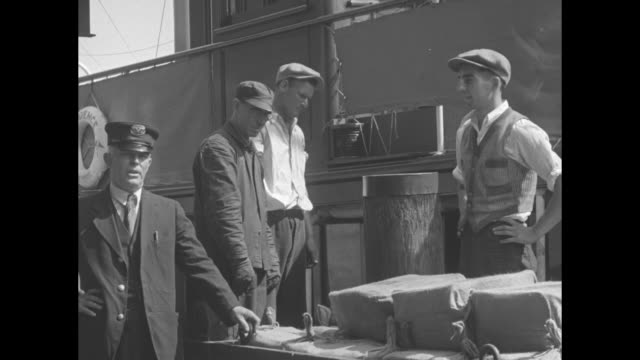 """""""seized yacht yields $250,000 pre-war liquor - customs officers unload valuable cargo of whiskey at boston, mass."""" / large yacht """"prudence of new... - 荒い麻布点の映像素材/bロール"""