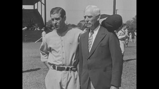 stockvideo's en b-roll-footage met senators get set for opening game / large paper baseball 1938 with washington senators coach nick altrock sticking his head through to the amusement... - 1938