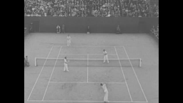 """""""sensational tennis marks finals for davis cup"""" / several action shots of game in stade roland-garros between french doubles team of jacques brugnon... - davis cup stock-videos und b-roll-filmmaterial"""