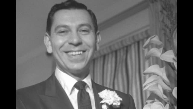 'Sgt Friday Weds Actress on Tuesday' superimposed over actor Jack Webb and bride Dorothy Towne speaking to officiate Judge Ward at their wedding /...