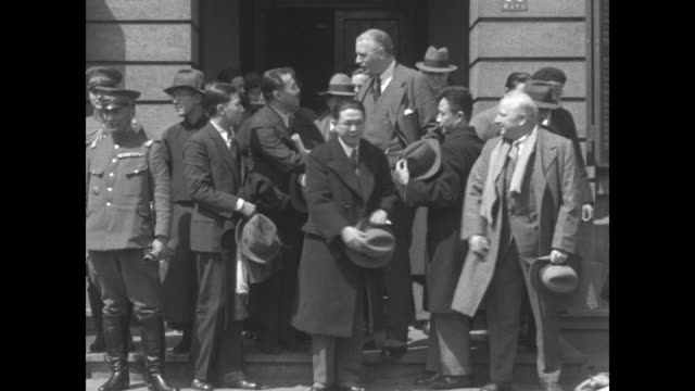 """shanghai peace moves, shanghai -- sir miles lampson, british minister to china, introduces japanese peace delegate shigamitsu and chinese mr. quo... - manchuria region stock videos & royalty-free footage"