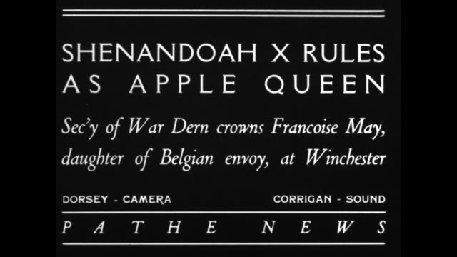 shenandoah x rules as apple queen sec'y of war dern crowns francoise may daughter of belgian envoy at winchester / us war secretary george dern holds... - laubbaum stock-videos und b-roll-filmmaterial