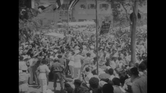 shepilov woos nasser on the banks of the nile superimposed over shepilov and nasser with others / shepilov with nasser / excited egyptian crowds... - foreign minister stock videos and b-roll footage