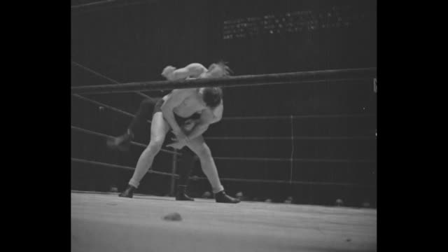 'Shikat Wins Mat Title' / two action shots of wrestling match in Madison Square Garden between Danno O'Mahoney and Dick Shikat / Shikat pins...