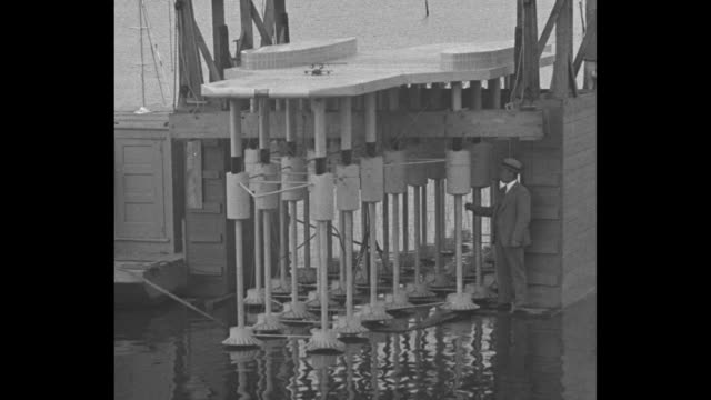 'Shows Seagoing Airfield Model Cambridge MD Inventor Armstrong explains seadrome planned as airport' / shot of Edward Armstrong standing at bottom of...