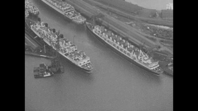 stockvideo's en b-roll-footage met six of england's sea queens meet in port for first time these unusual air views show aquitania berengaria mauretania homeric majestic and empress of... - southampton engeland