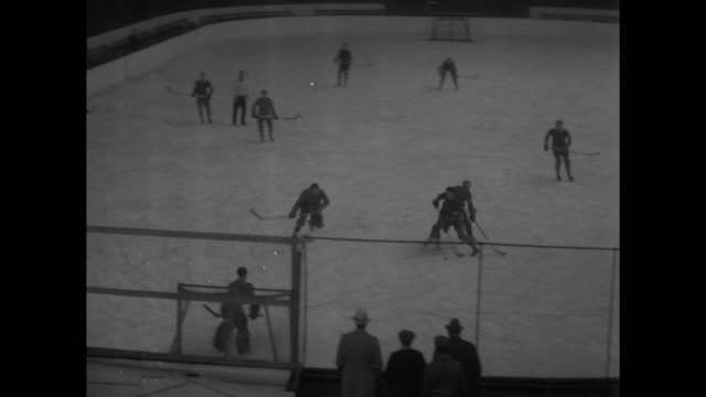 skating season nears as hockey stars warm up new york rangers train for cold weather sport in springfield mass / various action shots of rangers... - springfield massachusetts stock videos & royalty-free footage