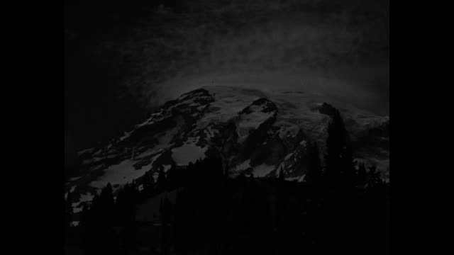 ski fans find snow even when it's hot / title mt rainier wash superimposed over ws mt rainier / shot of ski lodge / ws mt rainier / shot of ski lodge... - ski lodge stock videos & royalty-free footage