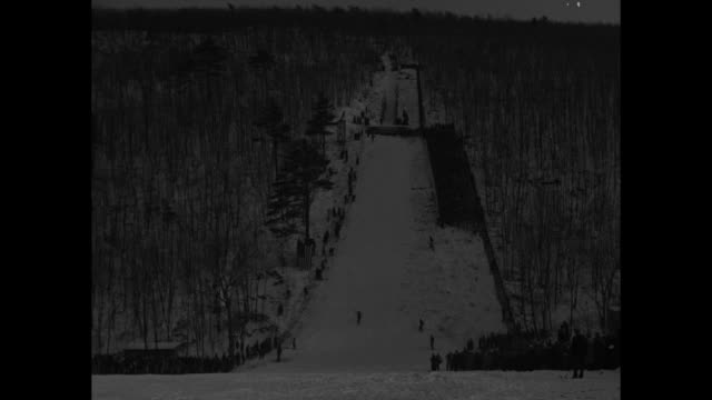 ski jumping champions new york state title meet at salisbury mills tests their nerve / ls ski jump with jumper approaching camera after making a nice... - v neck stock videos & royalty-free footage
