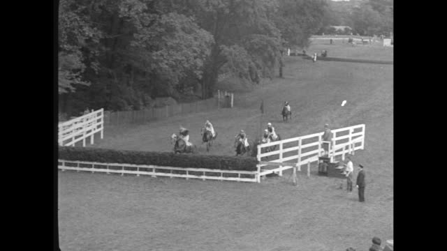 """""""society thrills and spills at gala brookline horse meet-fair weather adds zest to annual steeplechase events at massachusetts country club"""" / crowd... - barricade stock videos & royalty-free footage"""