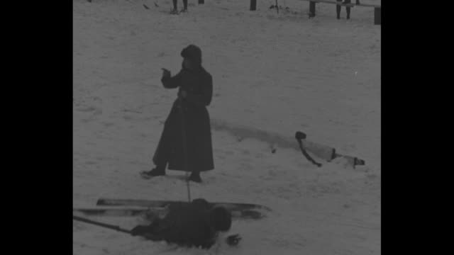 soldiers put pep in winter sports ft snelling minn doughboys test skill with skis and snowshoes in post tournament / line of young men on skies begin... - maultier stock-videos und b-roll-filmmaterial