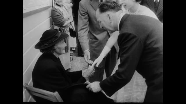 'Special Release New Zealand Queen Visits Whistle Stops' / Rotorua NZ 1/2/54 montage New Zealand Prime Minister Sidney Holland leads Queen Elizabeth...