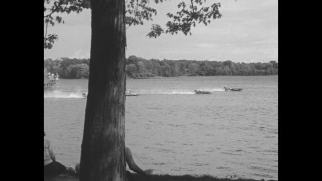vídeos y material grabado en eventos de stock de speedy outboards bounce on ottawa daring drivers push tiny craft to limit in seigniory club regatta over 2 1/2 mile course at lucerneinquebec / vs... - río ottawa