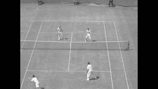"""""""sports flashes"""" over black then superimposed over tennis match / high angle shot doubles match at davis cup at the west side tennis club in forest... - davis cup stock-videos und b-roll-filmmaterial"""