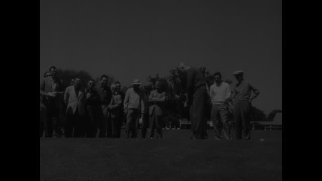 Sports Ike and Top Amateur Golf at Augusta superimposed over people walking on golf course at Augusta National Golf Club / President Dwight...