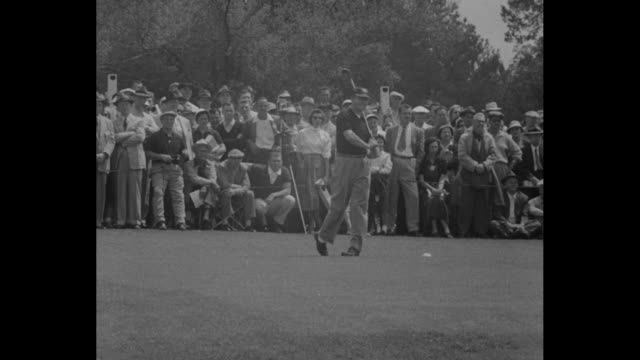 Sports / Playoff winner Snead cops 3rd Masters' Crown superimposed over men shaking hands on golf course / men playing golf as crowd watches / QS...