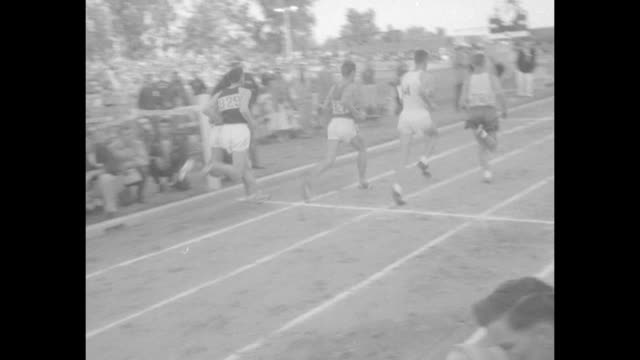 stockvideo's en b-roll-footage met sports / title amazing landy runs sixth 4minutemile superimposed over smiling australian runner jack landy at the west coast relays / runners begin... - fresno californië