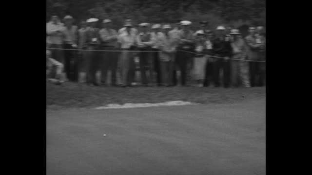 vídeos y material grabado en eventos de stock de sports / title ben hogan wins fourth open title superimposed on hogan in coat and tie / hogan misses putt / gallery moves / long putt misses / sam... - putt