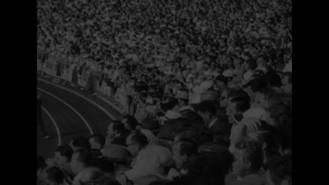 SPORTS / title card European Games BANNISTER RED ATHLETES STAR superimposed over start of 1500meter race / crowd looks on / racers move away as race...