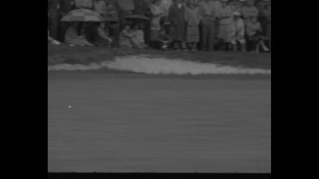 Sports / Title Hogan Wins Masters Golf superimposed over spectators amidst pine trees / LS across water spectators on hill with Hogan wearing light...