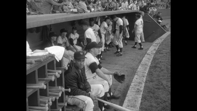 Sports / title Leo Durocher Leaves NY Giants superimposed over New York Giants manager Leo Durocher walking off baseball field to dugout / Giants...