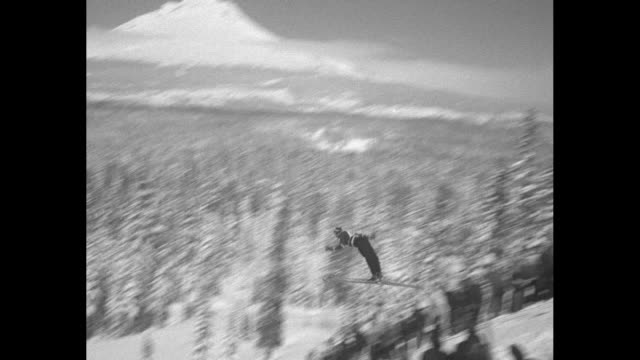 sports / title no american ski jumping championships superimposed over skiers standing in a row / ls snow covered mount hood / skier comes flying... - mt hood stock videos & royalty-free footage