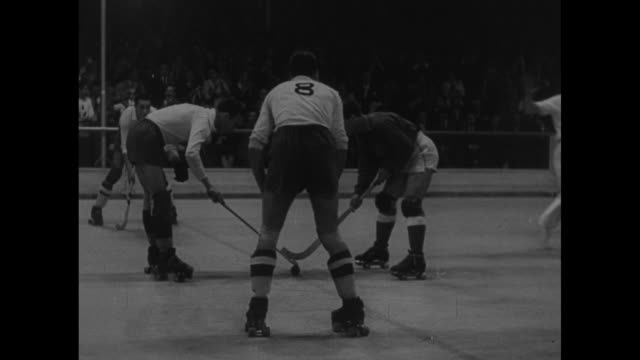 """sports"" / title "" world roller hockey championships!"" superimposed over hockey players roller skating onto rink / crowd in stands wildly cheering /... - world sports championship stock videos & royalty-free footage"