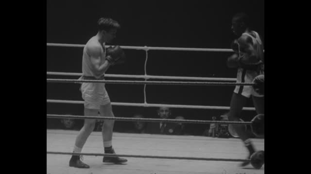 sports / top british us amateur boxers meet superimposed over boxing ring / vs boxers box including us boxer randy sandy fight judges at ringside... - boxing ring stock videos & royalty-free footage